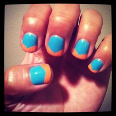Baby blue and orange nails.