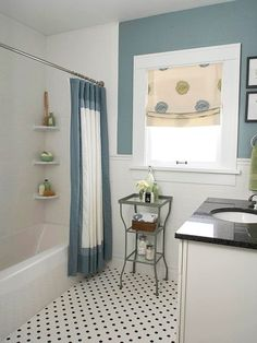 tile, white vanity and black counter top ARTICLE + GALLERY:11 Mosaic Tile Floors Shining w/ Vintage Style