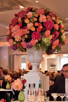 Beautiful pink, orange & apricot flower arrangement by Hayford & Rhodes