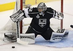 Los Angeles Kings goalie Jonathan Quick makes a save against the New Jersey Devils during the first period during Game 3 of the NHL Stanley Cup hockey finals in Los Angeles he ended the night with a 4-0 shutout.