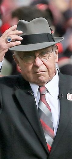 """Former Ohio State football head coach Earle Bruce acknowledges the crowd after dotting the """" I """" before the game against Rutgers, Saturday"""