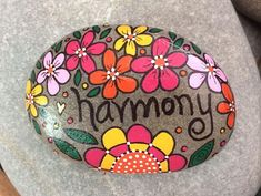 Hand-painted, one-of-a-kind Happy Rock - HARMONY. This beautiful rock was found on the coast of Maine. No two rocks are alike - nature intended it that way! They are oddly shaped and have spots and holes and cracks and variations in color and each one is beautiful! Happy Rocks add