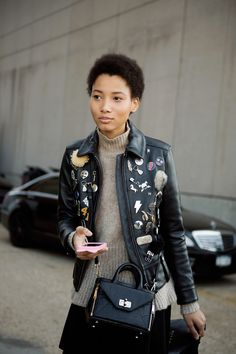 leather jacket with pins and patches
