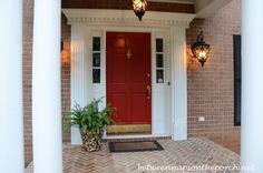 Red front door painted in Benjamin Moore, Heritage Red