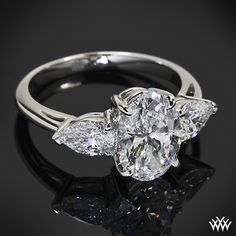 To dream the impossible dream   Custom Oval and Pear 3 Stone Engagement Ring...pretty