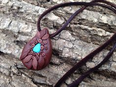 Turquoise feather necklace, dream catcher pendant on leather on Etsy, $30.00