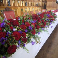 Cascading top table design at Middle Temple Hall as created and installed by www.kwfloraldesign.co.uk