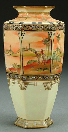 A NIPPON MAN ON CAMEL DECORATED PORCELAIN VASE CIRCA 1910 WITH HAND PAINTED SCENE ON 6 PANELS