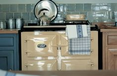 The 3-oven AGA cooker in Cream with insulated lid raised.
