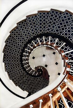 incredible black and white tiled spiral staircase // foyers