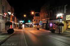 Main Street Newmarket at night lit by streetlights. Newmarket Ontario Canada