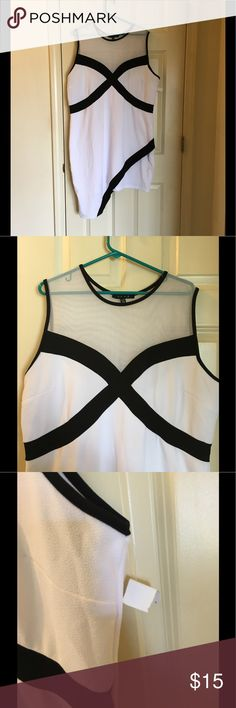 NWT 3X Colorblock Dress by Snap New with tags!  White and black colorblock inspired dress.  Mesh top.  The dress is lined so it's not a see through white.  Dramatic asymmetrical hemline.  Size 3X.  By Snap.  Dress is 39 inches long at mid point.    Important:   All items are freshly laundered as applicable prior to shipping (new items and shoes excluded).  Not all my items are from pet/smoke free homes.  Price is reduced to reflect this!   Thank you for looking! Snap Dresses Asymmetrical