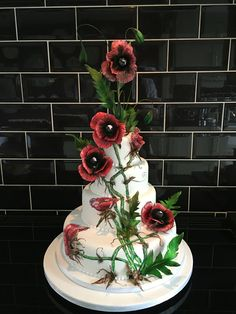 Our latest design featuring hand painted poppies and 3D sugar poppies to give s dramatic effect ...