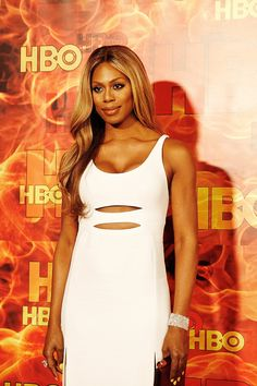 """Laverne Cox of """"Orange Is the New Black"""" attended HBO's fire-themed party after the Emmys in a cutout dress by Calvin Klein. (Photo: Emily Berl for The New York Times)"""