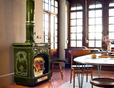 Wood-burning ceramic stove with Thermal Accumulation LIBERTY by Sergio Leoni