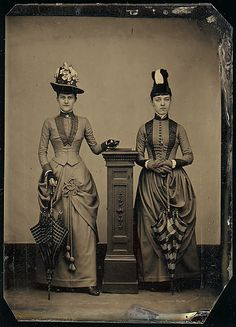 circa 1870 two ladies all decked out, wild hats and parasols!! from the Metropolitan Museum of Art