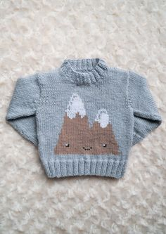 This is my basic sweater pattern with a cute mountain range on the front. This would be nice to wear any time of year!This pattern comes with written instructions and mountain chart.