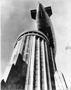 "The dirigible ""Columbia,"" flying over the mast of the Empire State Building."