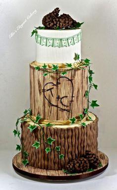 Rustic Wedding Cake with pine cones by Ellie @ Ellie's Elegant Cakery - http://cakesdecor.com/cakes/262107-rustic-wedding-cake-with-pine-cones