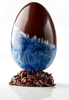 A chocolate Easter egg inspired by the coast of Brittany from Henri Le Roux. Easter Chocolate, Chocolate Art, Chocolate Flavors, Chocolates, Chocolate Showpiece, Chocolate Covered, Chocolate Centerpieces, Easter Egg Designs, Chocolate Shells