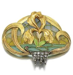 GOLD ENAMEL AND DIAMOND BROOCH, CIRCA 1900 with a chased gold brooch depicting an iris decorated with white and green enamel to a plique-à-jour enamel background, accented with a cascade of rose-cut diamonds