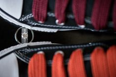 Wedding rings between two custom patent leather Converses at the Marriott Crystal City in Arlington VA. Caputred by Northern Virginia wedding photographer Ben Lau.