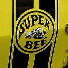 mopar Automotive Logo, Dodge Coronet, Dodge Chrysler, Classy Cars, Mopar Or No Car, Car Logos, Hood Ornaments, Man Standing, Drag Cars