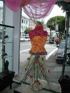 This is made out of silk flowers by Dona Taylor owner of Gallery of Jewels in SF  We sell new and used mannequins and forms at Mannequin Madness for projects like this.