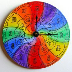 "Color Wheel Clock - Rainbow   by Christine Bailey-Claringbold  The Color Wheel Clock features the artist's original, psychedelic mandala design, hand painted using high quality acrylics. It is made from an upcycled 12"" vinyl LP record. Price: $55.00  On Artful Vision, a portion of your gift purchase is donated to a participating non-profit of your choice."