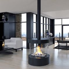 Ortal Island Gas Fires look stunning in any large open space offering a unique panoramic view of the fireplace that unifies the design of a room. Available now from Robeys in Derbyshire. Hanging Fireplace, Home Fireplace, Fireplace Design, Fireplace Glass, Contemporary Gas Fires, Interior Exterior, Interior Design, Simple Kitchen Design, Kitchen Living
