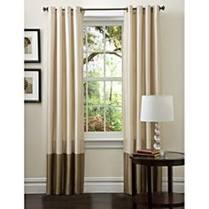 @Overstock.com -  Prima Ivory/ Taupe Curtain Panels (Set of 2) - Give your window the look of an upscale spa with these classic curtain panels. The pale ivory color complements the darker taupe shade at the bottom, creating a soft and rich look, and the loops along the top make hanging the pieces easy.  http://www.overstock.com/Home-Garden/Prima-Ivory-Taupe-Curtain-Panels-Set-of-2/7018505/product.html?CID=214117 $35.99