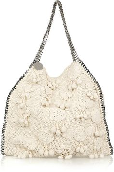 Cream crocheted shoulder bag with a gunmetal chain-detailed whipstitch trim and top handles. Stella McCartney bag has a flower and pompom embellishment, a magnetic-fastening top, a designer-stamped disc at top, a detachable zip-fastening purse, internal zip-fastening and pouch pockets, and is fully lined in cream twill. Designer color: Clotted Cream.