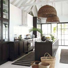 Black minimalist kitchen with wicker accessories