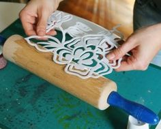 make stencil from foam & stick to rolling pin, ready to print