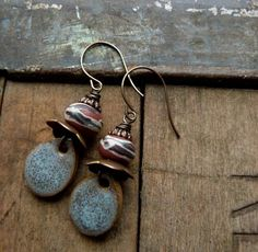 I do so love Heather Power's Humble Beads. These earrings are designed by Lorelei Eurto -- nice rhythm and scale in the design.