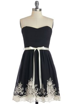 Black & ivory dress with such pretty detailing along the hemline