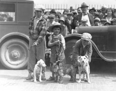 """W.L. Feeney, the manager of the RKO Pantages Theater, organized a very special """"real old fashioned mutts"""" dog show on April 19, 1930 to welcome the Weaver Brothers comedy team to Tacoma. The winners of the show were: (l to r) Earl Robinson with his two month old puppy Spot, second place; Dickie Dale Simmons with first place winner Bud; and Harold Hilderman with his $1.00 cash prize winning pooch Jiggs. Four year old Dickie made sure that no one could run off with his prize winning pet; Bud…"""