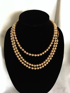 """See new listings daily - follow us for updates.  Christmas in July Sale KJL - Kenneth Jay Lane - 60"""" Hand Knotted Glass Imitation Champagne Pearl Necklace - Confirmed Yellow Gold Plated Logo Clasp - Rope Style -  #Wedding ... #vintage #jewelry #teamlove #etsyretwt #bestofetsy #mimisjewelryboutique #wedding ➡️ http://jto.li/wBcFD"""