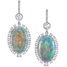 Platinum opal and rose cut diamond earrings. Opals weigh a total of the rose cut diamonds weigh a total of Opal Earrings, Opal Jewelry, Diamond Jewelry, Fine Jewelry, Jewelry Box, Jewellery, Stylish Jewelry, Luxury Jewelry, Fantasy Jewelry