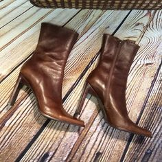 "STEVE MADDEN MID-CALF BROWN LEATHER SIDE ZIP BOOTS These are one fabulous pair of boots.. They hit mid calf with a fitted style. If you have a wide calf these won't work for you.. Side zip ..They have a couple of dings but nothing that effects the Beauty of them. 4"" heel Steve Madden Shoes Heeled Boots"