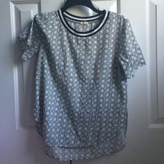 Black and white detailed high/low shirt Black and white with details. From hollister, never worn Hollister Tops Blouses