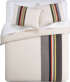 A sophisticated pop of colors from stripes in an updated placement!  It's masculine enough for our male side and soft enough for our girl's.  Versatile, too, as it would look great on most any era bed.  rajika bed linens in bed linens | CB2
