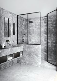 See the work of interior designer and blogger Katty Schiebeck: Dark grey marble in the Eixample-district apartment by Schiebeck.