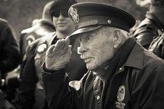 WWII veteran saluting.