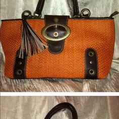 ADRIENNE VITTADINI BURNT ORANGE HANDBAG  Adrienne VIttadini Burnt Orange Handbag-This reposhed bag is too small for me. It has a dark brown leather double strap and accents; inside features large compartment with zippered pocket. Main compartment zips shut with a large decorative flip over buckle with a magnetic closure. Adrienne Vittadini Bags