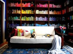 Color coded bookcase. Love this idea, tried it... I could never find the book I wanted.