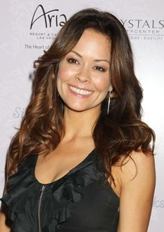 Brooke Burke's long, curly hairstyle