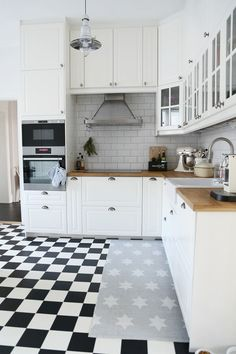 Smaller black & white tiles + white cabinets + butcher block counter + white subway tile