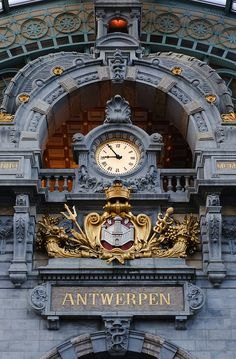 The clock at Antwerpen-Central Railway Station,...
