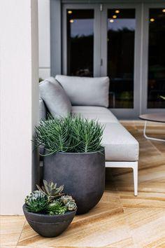 dark grey round planters   adamchristopherdesign.co.uk